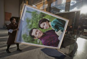 Men carry a portrait of King Jigme Khesar Namgyel Wangchuck and his wife Jetsun Pema to display inside a modern office building in Bhutan's capital Thimphu. (Photo: Reuters/Adrees Latif).