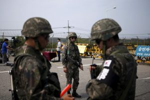 South Korean soldiers stand guard at a checkpoint on the Grand Unification Bridge, south of the DMZ, in Paju, South Korea, 24 August 2015 (Photo: Reuters/Kim Hong-Ji).