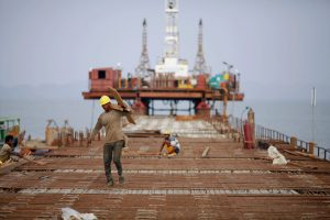 Workers from Indian conglomerate Essar Group construct a new port in Sittwe, 19 May 2012. (Photo: Reuters/Damir Sagolj).
