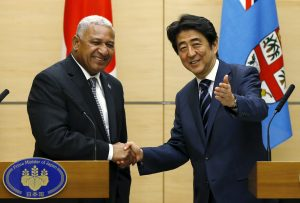 Fiji's Prime Minister Josaia Voreqe Bainimarama shakes hands with Japan's Prime Minister Shinzo Abe at the end of their joint news conference at Abe's official residence in Tokyo 19 May 2015 (Photo: Reuters/Issei Kato).