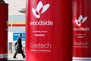 Logos of Woodside Petroleum are seen at Gastech, the world's biggest expo for the gas industry, in Chiba, Japan, 4 April 2017 (Photo: Reuters/Toru Hanai).