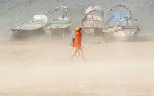 A Sadhu or a Hindu holy man walks on the banks of the river Ganges during a dust storm in Allahabad, India, 9 June 2016 (Photo: Reuters/Jitendra Prakash).