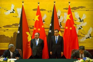 Papua New Guinea's Prime Minister Peter O'Neill and Chinese Premier Li Keqiang watch a signing ceremony at the Great Hall of the People in Beijing, China. (Photo: Reuters/Mark Schiefelbein).