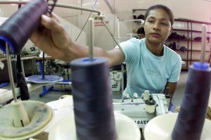 Fijian garment workers make clothing for export in a factory in the capital Suva, 26 July 2000 (Photo: Reuters).