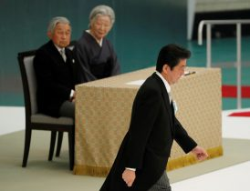 Japan's Emperor Akihito and Empress Michiko look at Japanese Prime Minister Shinzo Abe during a memorial service ceremony marking the the 73rd anniversary of Japan's surrender in World War Two, Budokan Hall, Tokyo, Japan, 15 August 2018 (Photo: Reuters/Toru Hanai).