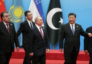 Russian President Vladimir Putin, President of the People's Republic of China Xi Jinping and President of the Republic of Tajikistan Emomali Rahmon are seen during a photo session of the Shanghai Cooperation Organisation in Qingdao, China, 10 June, 2018 (Photo: Reuters/Sputnik).