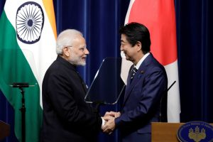 Narendra Modi, India's Prime Minister, and Shinzo Abe, Japan's Prime Minister, shake hands during a joint news conference at Abe's official residence in Tokyo, Japan, 29 October 2018 (Photo: Kiyoshi Ota/Pool via Reuters).