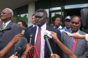 Solomon Islands' prime minister Manasseh Sogavare speaks to the media outside Parliament House in capital Honiara 4 May 2006 (Photo: Reuters/Walter Nalangu).