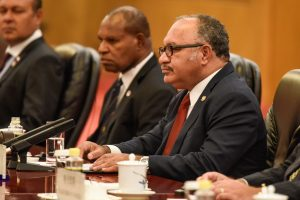 Papua New Guinea Prime Minister Peter O'Neill speaks to China's President Xi Jinping during a meeting at the Diaoyutai State Guesthouse in Beijing, China, 21 June 2018 (Photo: Reuters/Fred Dufour).