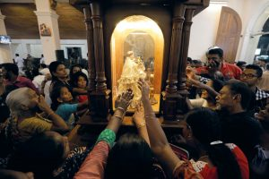 Devotees pray during the reopening ceremony of the St. Anthony's Shrine, one of the churches attacked in the April 21st Easter Sunday bombings in Colombo, Sri Lanka 12 June 12 2019. (Photo: Reuters/ Dinuka Liyanawatte).