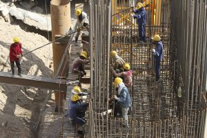 Workers build on a Chinese-funded bridge. (Photo: Reuters/Samrang Pring).