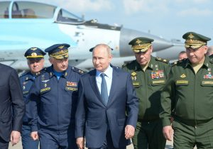 Russian President Vladimir Putin, accompanied by Defence Minister Sergei Shoigu and Chief of the General Staff of Russian Armed Forces Valery Gerasimov, tours an exhibition of military transport and equipment as he visits a Defence Ministry's flight test centre in the town of Akhtubinsk in Astrakhan Region, Russia, 14 May 2019 (Photo: Reuters/Sputnik/Alexei Nikolsky).