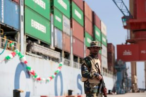A soldier stands guard beside the Cosco Wellington, the first container ship to depart after the inauguration of the China Pakistan Economic Corridor port in Gwadar, Pakistan November 13, 2016. (Photo: Reuters/Caren Firouz)