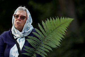 A woman holds a fern during a vigil for the victims of the mosque attacks during an ecumenical celebration in Christchurch, New Zealand, March 21, 2019. (Photo: Reuters/Jorge Silva).