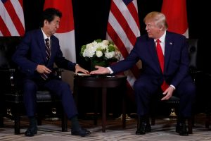 US President Donald Trump reaches out to shake hands with Japan's Prime Minister Shinzo Abe during a bilateral meeting on the sidelines of the 74th session of the United Nations General Assembly (UNGA) in New York City, New York, US, 25 September 2019 (Photo: Reuters/Jonathan Ernst).