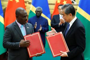 Chinese State Councillor and Foreign Minister Wang Yi andSolomonIslandsForeign Minister Jeremiah Manele attend a signing ceremony at the Great Hall of the People in Beijing, China, 9 October 2019 (Photo: Reuters/Thomas Peter).