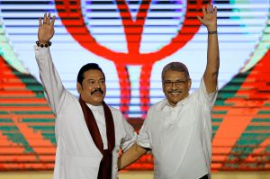 Sri Lanka's former defence secretary Gotabaya Rajapaksa (R) waves next to his brother and former President Mahinda Rajapaksa after he was nominated as a Presidential candidate during the Sri Lanka People's Front party convention in Colombo, Sri Lanka, 11 August 2019 (Photo: Reuters/Dinuka Liyanawatte).