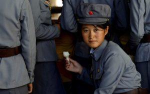 A soldier eats ice cream in Pyongyang, North Korea, 12 September 2018 (Photo: Reuters/Danish Siddiqui).