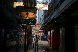 A man walks between stalls in an alley in the Central business district inHongKong, 22 August, 2019 (Photo: Reuters/Thomas Peter).