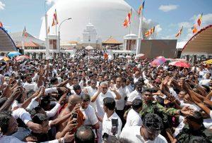 Sri Lanka's President Gotabaya Rajapaksa waves at his supporters as he leaves the presidential swearing-in ceremony in Anuradhapura, Sri Lanka, 18 November 2019 (Photo: Reuters/Dinuka Liyanawatte).