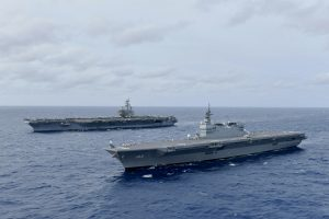 The Navy's forward-deployed aircraft carrier USS Ronald Reagan operates with the Japan Maritime Self-Defense Force helicopter carrier JS Izumo in the South China Sea, 11 June 2019 (Photo: Reuters).
