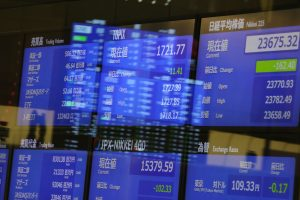 An electronic stock board displays the Tokyo Stock Exchange in Tokyo, Japan (Photo: Reuters/Yohei Osada/AFLO).