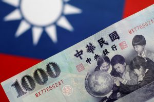 A Taiwan dollar note is seen in this illustration photo, 31 May 2017 (Photo: Reuters/Thomas White).
