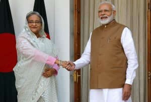 India's Prime Minister Narendra Modi shakes hands with his Bangladeshi counterpart Sheikh Hasina before their meeting at Hyderabad House in New Delhi, India, 5 October 2019 (Photo: Reuters/Altaf Hussain).