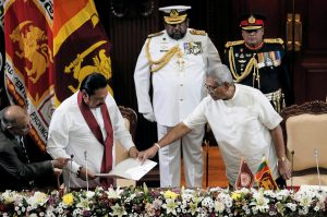 Sri Lanka's President Gotabaya Rajapaksa and his brother and former leader Mahinda Rajapaksa, who was appointed as the new Prime Minister, are seen during the swearing in ceremony in Colombo, Sri Lanka 21 November, 2019 (Photo: Reuters/Liyanawatte).