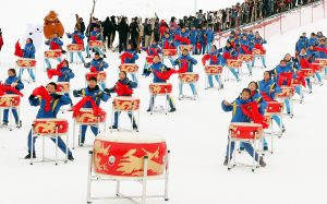 Local students drum dance at the opening ceremony of the 14thXinjiangWinter Tourism Trade Fair and the skiing carnival at a skiing field on Jiangjun Mountain in Altay, northwest China'sXinjiangUyghur Autonomous Region, 27 November 2019 (Photo: Reuters/Imagine China/Zhang Xiuke).