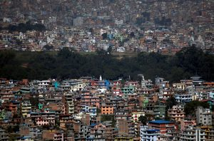 A tree line is pictured between the densely built houses and buildings of Kathmandu Nepal 14 November, 2019 (Photo: Reuters/Chitrakar).