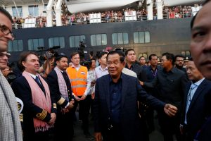 Cambodia's Prime Minister Hun Sen welcomes crews of MS Westerdam, a cruise ship that spent two weeks at sea after being turned away by five countries over fears that someone aboard might have the coronavirus, as it docks in Sihanoukville, Cambodia, 14 February 2020 (Photo: Reuters/Soe Zeya Tun).