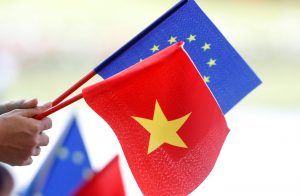 European Union and Vietnamese flags are seen at the signing ceremony of EU-Vietnam Free Trade Agreement at the government office in Hanoi, Vietnam, 30 June 2019 (Reuters/Kham).