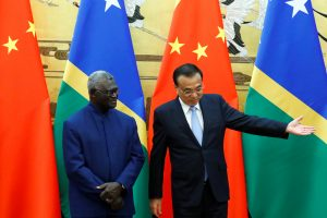 Solomon Islands Prime Minister Manasseh Sogavare and Chinese Premier Li Keqiang attend a signing ceremony at the Great Hall of the People in Beijing, China, 9 October 2019 (Photo:Reuters/Thomas Peter).