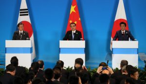 (L to R) South Korea's President Moon Jae-in, China's Premier Li Keqiang and Japan's Prime Minister Shinzo Abe attend a joint press coference after the 8th trilateral summit meeting in Chengdu, China on 24 December 2019 (Photo: Reuters/The Yomiuri Shimbun).