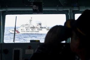 China Coast Guard ship is seen from an Indonesian Naval ship during a patrol at Indonesia's Exclusive Economic Zone sea in the north of Natuna island, Indonesia, 11 January, 2020 (Photo: Reuters/Antara Foto/M Risyal Hidayat).