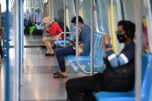 Commuters are seen wearing face masks in an almost empty SBK train as a precaution against the spread of COVID-19 in Kuala Lumpur, Malaysia (Photo: Reuters/Hazim Mohammad).