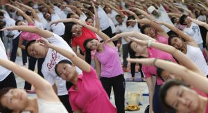 Participants exercise during Mega Yoga Day in Kuala Lumpur. The event, which aims to hold the largest gathering of yoga participation in Malaysia, also promotes national awareness of physical fitness and an active lifestyle through exercise, according to government organisers in Kuala Lumpur, Malaysia, 27 October 2013 (Reuters/Samsul Said).