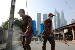 Firefighters spray disinfectant on a street during the movement control order due to the outbreak of the coronavirus disease (COVID-19), in Kuala Lumpur, Malaysia 31 March, 2020 (Photo: Reuters/Teng).