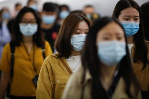 People wearing face masks walk inside a subway station during morning rush hour, following an outbreak of the coronavirus disease (COVID-19), in Beijing, China 11 May, 2020 (Photo: Reuters/Carlos Garcia Rawlins).