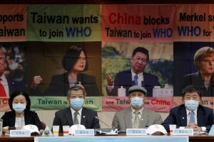 Taiwan Health Minister Chen Shih-chung, parliament members and activists hold a news conference about Taiwan's efforts to enter the World Health Organization, Taipei, Taiwan, 15 May 2020 (Photo: Reuters/Ann Wang).