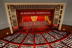 Chinese officials and delegates attend the opening session of the Chinese People's Political Consultative Conference (CPPCC) at the Great Hall of the People in Beijing, China, 21 May 2020 (Photo: REUTERS/Carlos Garcia Rawlins).