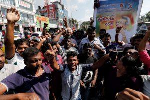 Supporters of Sri Lanka People's Front party presidential election candidate and former wartime defence chief Gotabaya Rajapaksa celebrate after he won the presidential election in Colombo, Sri Lanka, 17 November 2019. (Photo: Reuters/Dinuka Liyanawatte).