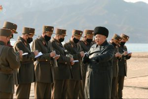 North Korean leader Kim Jong-un, the only one not wearing a coronavirus mask, watches his troops fire rockets and artillery shells, 13 March 2020 (Photo: Korean Central News Agency via Reuters).