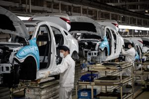 Staff of a local factory owned by Honda Motor Company, a Japanese public multinational conglomerate corporation primarily known as a manufacturer of automobiles, work to produce cars after a long Spring Festival vacation, Wuhan city, central China's Hubei province, 23 March 2020. (Photo: fachaoshi via Reuters).