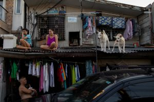 Girls hang out with their dogs on the roof of their house as the Philippine government enforces home quarantine to contain the coronavirus disease (COVID-19) outbreak in Metro Manila, Philippines, 21 April 2020. (Photo:Reuters/Eloisa Lopez).