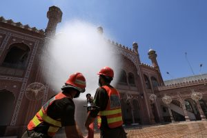 Rescue workers spray disinfectant while sanitising a mosque amid the coronavirus disease (COVID-19) outbreak, in Peshawar, Pakistan, 21 May 2020 (Photo: REUTERS/Fayaz Aziz).