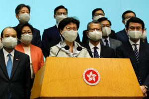 Hong Kong Chief Executive Carrie Lam, wearing a face mask following the coronavirus disease (COVID-19) outbreak, attends a news conference with officers over Beijing's plans to impose national security legislation in Hong Kong, China 22 May 2020 (Photo: Reuters/Tyrone Siu).