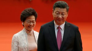 Hong Kong Chief Executive Carrie Lam and Chinese President Xi Jinping walk after Lam took her oath, during the 20th anniversary of the city's handover from British to Chinese rule, in Hong Kong, China, 1 July 2017 (Reuters/Bobby Yip/File Photo).