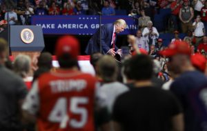 US President Donald Trump re-enacts his walking down a ramp at the end of a ceremony at West Point as he addresses his first re-election campaign rally in several months in Tulsa, Oklahoma, 20 June 2020 (Photo: REUTERS/Leah Millis).